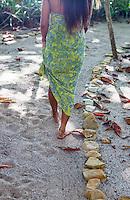 A guest walks down the beach path at Latitude 10 Resort, Santa Teresa, Costa Rica