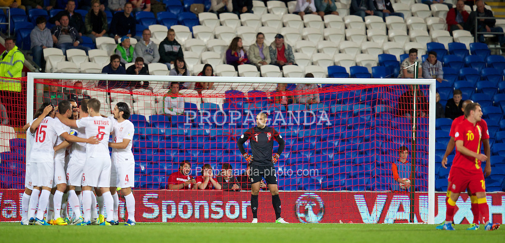 CARDIFF, WALES - Tuesday, September 10, 2013: Wales' goalkeeper Boaz Myhill looks dejected as Serbia score the opening goal during the 2014 FIFA World Cup Brazil Qualifying Group A match at the Cardiff CIty Stadium. (Pic by David Rawcliffe/Propaganda)