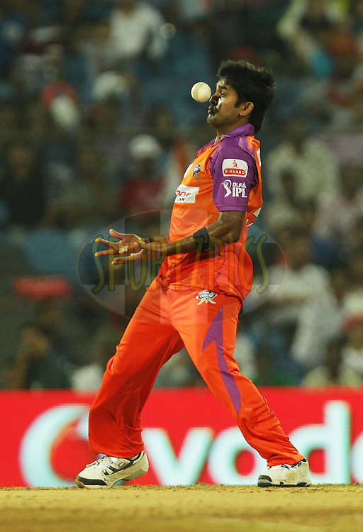 Vinay Kumar of Kochi Tuskers Kerala takes a return catch of Pune Warriors player Jesse Ryder during  match 10 of the Indian Premier League ( IPL ) Season 4 between the Pune Warriors and the Kochi Tuskers Kerala held at the Dr DY Patil Sports Academy, Mumbai India on the 13th April 2011..Photo by BCCI/SPORTZPICS