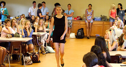Karissa Brown (far left) watches as models show designer L'Amour A-K Ameer their runway walks as he auditions prospective models during a Dayton Fashion Week meeting at SunWatch Indian Village/Archaeological Park in Dayton, Saturday, July 21, 2012.