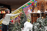 Chelsie Edwards of Melbourne, Kentucky adds some snow as the Huntington Holiday Train display setup nears completion at the main branch of the Columbus Metropolitan Library in downtown Columbus, Sunday, November 25, 2012..The trains are setup by Applied Imagination on Saturday and Sunday and will run through mid-January.