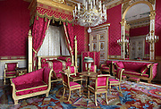 Bedroom of the Emperor, Castle of Compiegne, Oise, France. Most of the furniture was made by Jacob Desmalter and the chandelier with its thirty-two crystal reflectors dates from 1810. The castle was built in the 18th century in neoclassical style as the Royal residence for the French King Louis XV. It was destroyed during the French Revolution and later restored at the begining of 19th century by Napoleon in First French Emperor style with Louis-Martin Berthault as main architect. Picture by Manuel Cohen