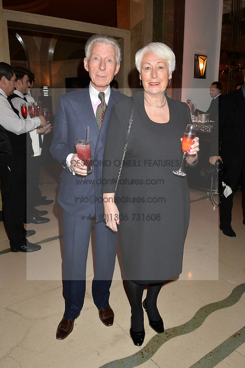 EDWARD SEXTON and his wife JOANNE at a reception hosted by The Rake Magazine and Claridge's to celebrate London Collections 2015 held at Claridge's, Brook Street, London on 8th January 2015.
