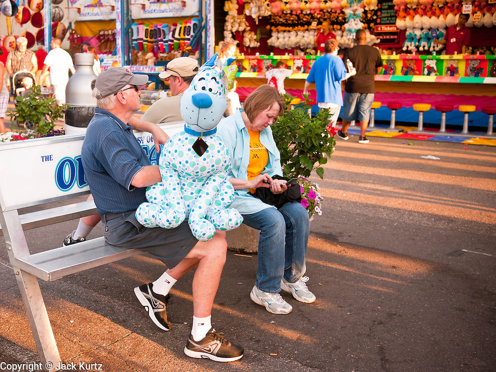 "01 SEPTEMBER 2011 - ST. PAUL, MN: People on the midway at the Minnesota State Fair. The Minnesota State Fair is one of the largest state fairs in the United States. It's called ""the Great Minnesota Get Together"" and includes numerous agricultural exhibits, a vast midway with rides and games, horse shows and rodeos. Nearly two million people a year visit the fair, which is located in St. Paul.   PHOTO BY JACK KURTZ"