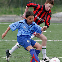 Holy Family's Denis Lupp and Ennis N.S Steven Murphy go head to head at the Ribena  5 aside national soccer blitz in Lees Road on Wednesday.<br /><br /><br /><br />Photograph by Yvonne Vaughan.
