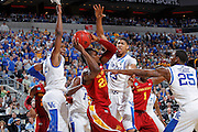 Anthony Davis #23, Marquis Teague #25 and Terrence Jones #3 of the Kentucky Wildcats surround Anthony Booker #22 of the Iowa State Cyclones during the third round of the NCAA men's basketball championship on March 17, 2012 at KFC Yum! Center in Louisville, Kentucky. Kentucky advanced with an 87-71 win. (Photo by Joe Robbins)