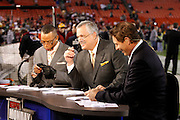 ESPN pregame analysts (L-R) Stuart Scott, Matt Millen, and Steve Young work the pregame set of ESPN Monday Night Countdown during the NFL week 10 football game against the Philadelphia Eagles on Monday, November 15, 2010 in Landover, Maryland. The Eagles won the game 59-28. (©Paul Anthony Spinelli)