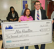 Houston ISD superintendent Dr. Terry Grier presents Alisa Hamilton a $10,000 scholarship funded by the Council of the Great City Schools at Bellaire High School, May 20, 2015.