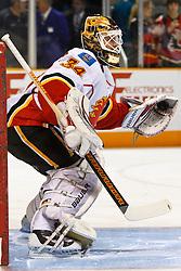 March 23, 2011; San Jose, CA, USA;  Calgary Flames goalie Miikka Kiprusoff (34) warms up before the game against the San Jose Sharks at HP Pavilion. San Jose defeated Calgary 6-3. Mandatory Credit: Jason O. Watson / US PRESSWIRE