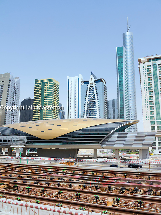 Skyline of skyscrapers and metro station at Jumeirah Lakes Towers development in Dubai United Arab Emirates