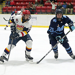 WELLINGTON, ON - FEBRUARY 15: Zack Uens #7 of the Wellington Dukes and Drake Lafontaine #25 of the St. Michael's Buzzers pursues the play in the second period on February 15, 2019 at Wellington and District Community Centre in Wellington, Ontario, Canada.<br /> (Photo by Ed McPherson / OJHL Images)