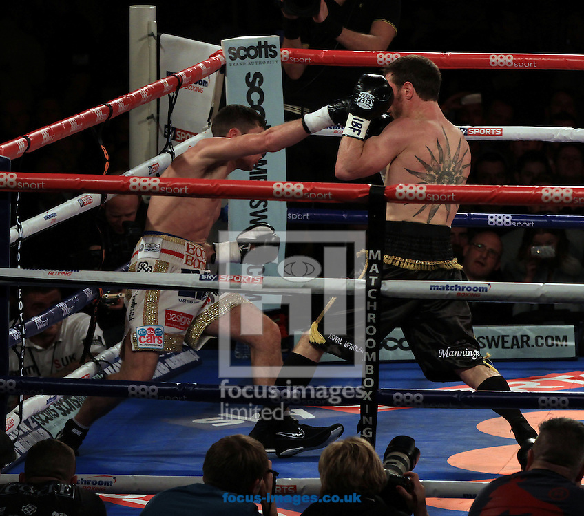 Tommy Coyle (white shorts) and Michael Katsidis (all black shorts) during their IBF International Lightweight Championship at Hull Ice Arena, Hull<br /> Picture by Richard Gould/Focus Images Ltd +44 7855 403186<br /> 25/10/2014