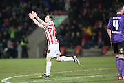 Jack Dunn celebrates his goal during the Sky Bet League 2 match between Cheltenham Town and Morecambe at Whaddon Road, Cheltenham, England on 16 January 2015. Photo by Shane Healey.