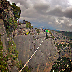 Nadeem AL-Kafaji onsighting an highline in Gorges du Verdon's sector of  Dalles Grises, France, while Mich Kemeter, BASE jumper, misses him in freefall by only a couple of feet of distance...© 2012 Pedro Pimentel