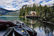 Rent canoes for paddling on pristine waters at Emerald Lake Lodge in Yoho National Park, British Columbia, Canada. Yoho is one of several Canadian Rocky Mountains parks which comprise a spectacular World Heritage Area listed by UNESCO in 1984.