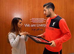 LIVERPOOL, ENGLAND - Friday, December 9, 2016: Liverpool's Emre Can is presented with the Goal 25 award by Liverpool correspondent Melissa Reddy at the club's Melwood Training Ground. (Pic by David Rawcliffe/Propaganda)