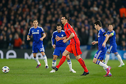 Zlatan Ibrahimovic of Paris Saint-Germain is challenged by Oscar of Chelsea - Photo mandatory by-line: Rogan Thomson/JMP - 07966 386802 - 11/03/2015 - SPORT - FOOTBALL - London, England - Stamford Bridge - Chelsea v Paris Saint-Germain - UEFA Champions League Round of 16 Second Leg.