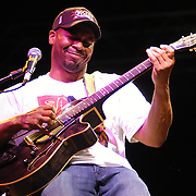 "Syracuse, NY / 2004 - Kevin Eubanks, featured performer at the ""Jazz in the Square"" concert series, plays guitar during the opening song of his act in Clinton Square. Photo by Mike Roy / For The Syracuse Post-Standard"