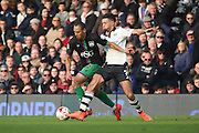 Bristol City striker, Peter Odemwingie (27) battling with Fulham defender Ryan Fredericks (07) during the Sky Bet Championship match between Fulham and Bristol City at Craven Cottage, London, England on 12 March 2016. Photo by Matthew Redman.