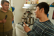 Irwin Sanchez talking with Victor Hernandez in Irwin's kitchen. Both are native speakers of Nahuatl, one of the Aztec languages of Mexico.