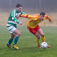 Avenue A's Mark Roche pushes Rhine Rover's Barry Ryan off the ball