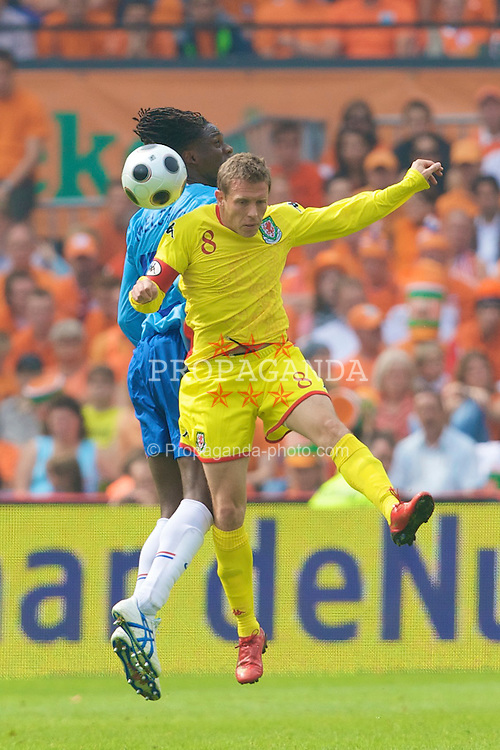 ROTTERDAM, THE NETHERLANDS - Sunday, June 1, 2008: Wales' Craig Bellamy and the Netherlands' Mario Melchiot during the international friendly match at the de Kuip Stadium. (Photo by David Rawcliffe/Propaganda)