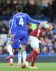 Chelsea's Cesc Fabregas catches Burnley's Michael Kightly in the head whilst competing for the ball - Photo mandatory by-line: Mitchell Gunn/JMP - Mobile: 07966 386802 - 21/02/2015 - SPORT - Football - London - Stamford Bridge - Chelsea v Burnley - Barclays Premier League