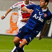 NLD/Amsterdam/20100731 - Wedstrijd om de JC schaal 2010 tussen Ajax - FC Twente, Siem de Jong in duel met Peter Wisgerhof