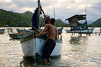 BARACOA, CUBA - CIRCA JANUARY 2020: Group of fisherman returning to Bahia de Mata, a hamlet close to Baracoa in Cuba.