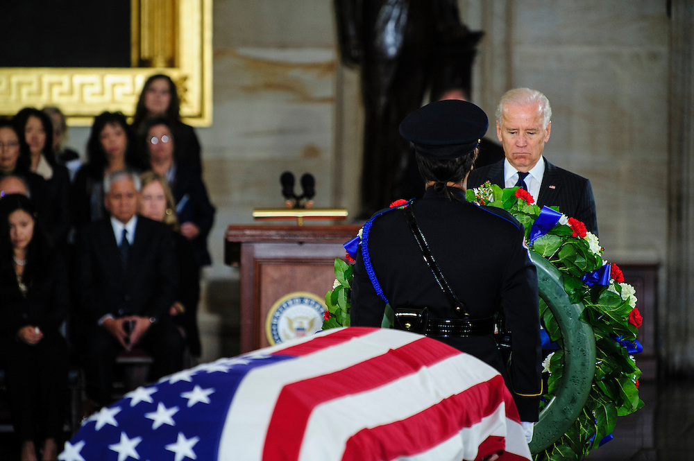 Vice President JOE BIDEN places a wreath in the Capitol Rotunda on Thursday during a service and public viewing of the late Senator Daniel Inouye (D-HI) who passed away at the age of 88 on December 18 at the Walter Reed National Military Medical Center in Bethesda, Md. Inouye, 88, a decorated World War II veteran and the second-longest serving senator in history will lie in state until Friday when a memorial service will be held at the National Cathedral.