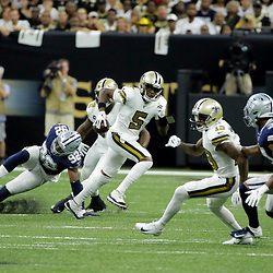 Sep 29, 2019; New Orleans, LA, USA; New Orleans Saints quarterback Teddy Bridgewater (5) scrambles out of the pocket against the Dallas Cowboys during the first quarter at the Mercedes-Benz Superdome. Mandatory Credit: Derick E. Hingle-USA TODAY Sports