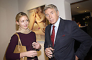 Kate Ewing and Don McCullin. Bettina Rheims private view. Hamiltons. 18 October 2001. © Copyright Photograph by Dafydd Jones 66 Stockwell Park Rd. London SW9 0DA Tel 020 7733 0108 www.dafjones.com