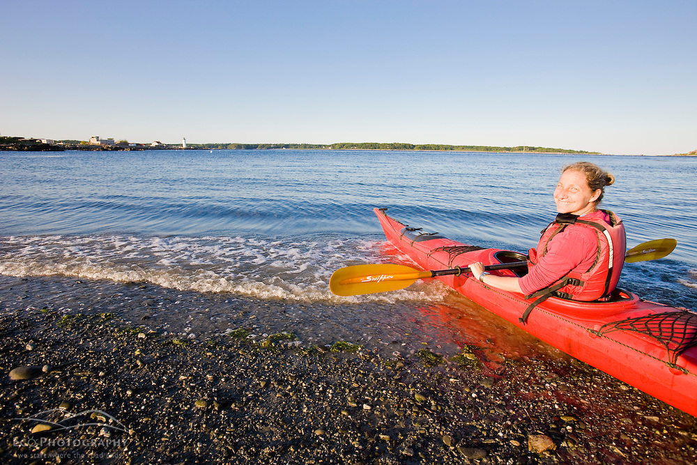 A woman kayaking in New Castle, New Hampshire.
