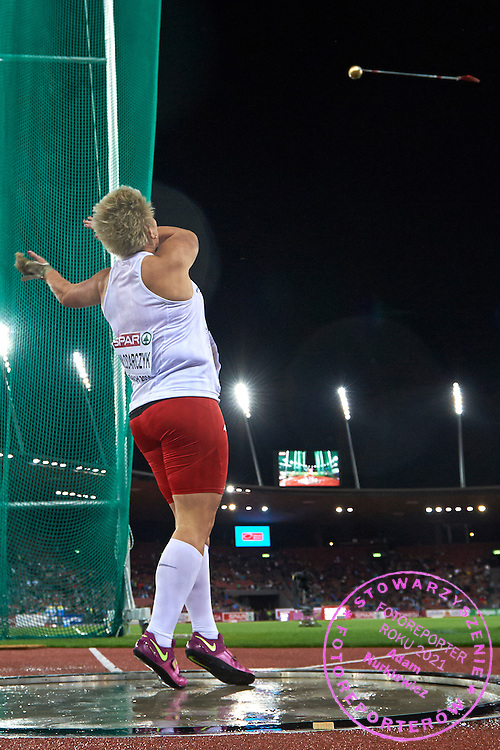 Anita Wlodarczyk from Poland competes in women's hammer throw final during the Fourth Day of the European Athletics Championships Zurich 2014 at Letzigrund Stadium in Zurich, Switzerland.<br /> <br /> Switzerland, Zurich, August 15, 2014<br /> <br /> Picture also available in RAW (NEF) or TIFF format on special request.<br /> <br /> For editorial use only. Any commercial or promotional use requires permission.<br /> <br /> Photo by &copy; Adam Nurkiewicz / Mediasport