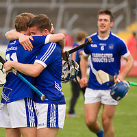 Brothers Padraic and Sean Collins embrace after their county final win