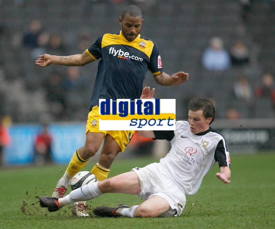 Photo: Steve Bond/Richard Lane Photography. MK Dons v Southampton. Coca-Cola Football League One. 20/03/2010. Jason Puncheon is tackled by David McCracken (?)
