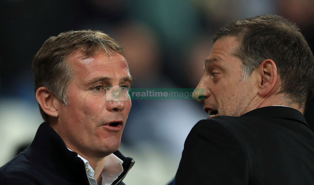 Bolton Wanderers manager Phil Parkinson (left) with West Ham United manager Slaven Bilic (right)