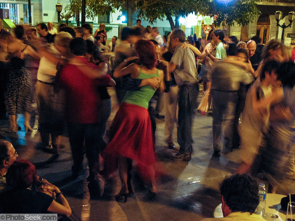 "Men and women dance tango at a free public dance held on Sundays in Dorrego Square, in San Telmo (""Saint Pedro González Telmo""), the oldest historic neighborhood (barrio) in Buenos Aires, in Argentina, South America."