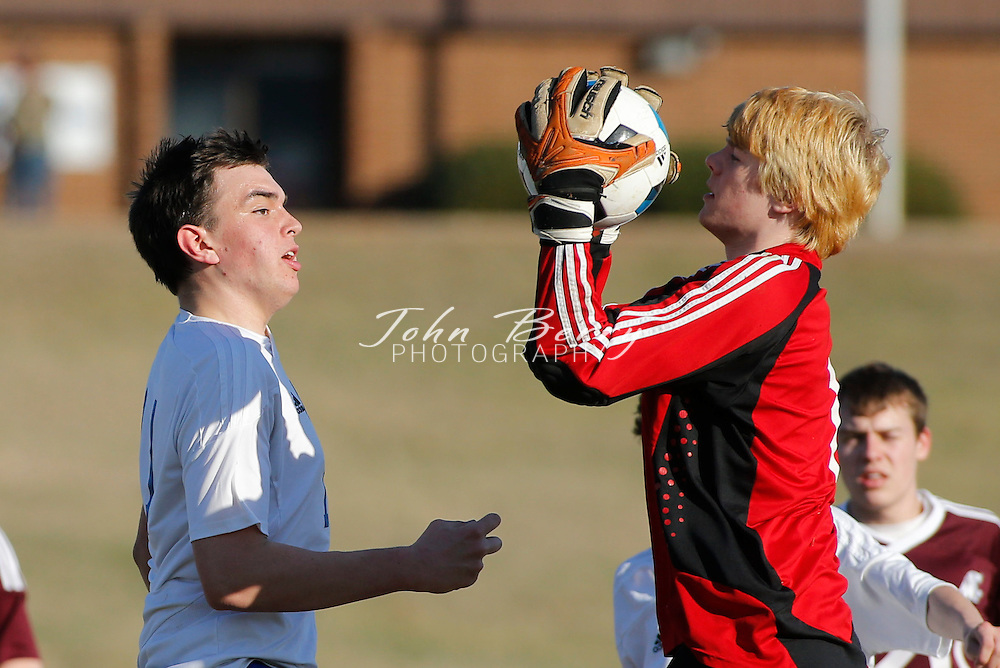 April 01, 2014.  <br /> MCHS Varsity Boy's Soccer vs Warren.  Madison loses to Warren 3-1.  Madison's goal was scored in the first half by Hayden Sealander on a Penalty Kick.