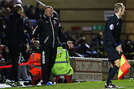 Chris Wilder, Manager of Northampton Town, (centre) isn't happy with a decision that goes against his side against Leyton Orient during the Johnstone's Paint Trophy match at the Matchroom Stadium London,<br /> Picture by David Horn/Focus Images Ltd +44 7545 970036<br /> 11/11/2014