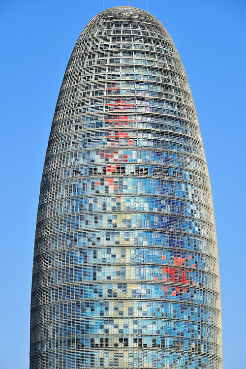 Torre Gl&ograve;ries in Sant Mart&iacute; District in Barcelona, Spain<br /> This bullet-shaped skyscraper in the Sant Mart&iacute; District was named Torre Agbar when it opened in 2004 as the headquarters of Grupo Agbar, an international water treatment company. Architect Jean Nouvel claims his design resembles a geyser. The unique, 472 foot fa&ccedil;ade features 4,500 windows with temperature-controlled levers and an equal number of LED lights that illuminate at night. Barcelona&rsquo;s third tallest building was renamed Torre Gl&ograve;ries in 2017 after the office high-rise was purchased by Merlin Properties.