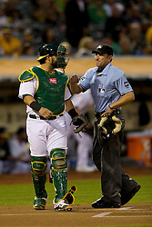 OAKLAND, CA - SEPTEMBER 23:  MLB umpire Chris Guccione #68 talks to Geovany Soto #17 of the Oakland Athletics before the game against the Los Angeles Angels of Anaheim at O.co Coliseum on September 23, 2014 in Oakland, California. The Los Angeles Angels of Anaheim defeated the Oakland Athletics 2-0.  (Photo by Jason O. Watson/Getty Images) *** Local Caption *** Chris Guccione; Geovany Soto