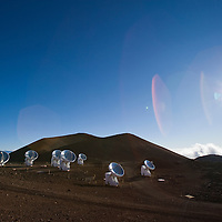 Mauna Kea Space Observatories; Submillimeter Array, The Submillimeter Array (SMA) is an 8-element radio interferometer located atop Mauna Kea in Hawaii. Operating at frequencies from 180 GHz to 900 GHz, the 6m dishes may be arranged into configurations with baselines as long as 500m, producing a synthesized beam of sub-arcsecond width. Each element can observe with two receivers simultaneously, with 2 GHz bandwidth each. The digital correlator backend allows flexible allocation of thousands of spectral channels to each receiver. The Submillimeter Array is a joint venture of the Smithsonian Astrophysical Observatory and the Academia Sinica Institute of Astronomy and Astrophysics.