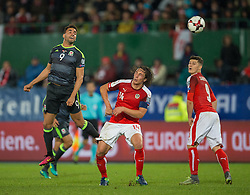VIENNA, AUSTRIA - Thursday, October 6, 2016:  Austria's Julian Baumgartlinger (R) in action against Wales' Hal Robson-Kanu (L) during the 2018 FIFA World Cup Qualifying Group D match at the Ernst-Happel-Stadion. (Pic by Peter Powell/Propaganda)