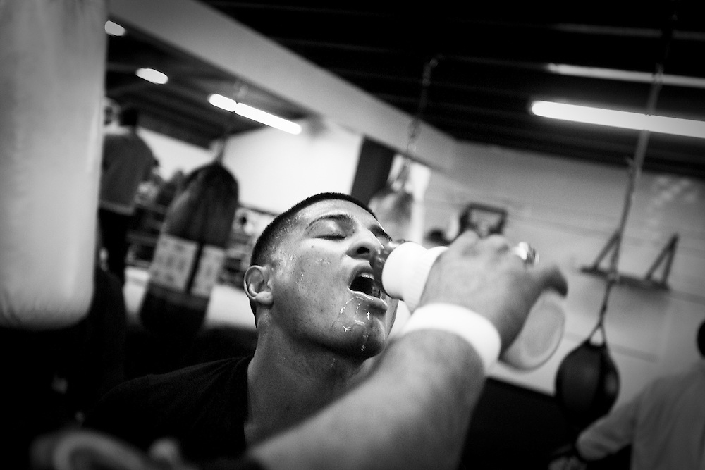 World champion boxer Abner Mares gets a drink during training. Photographed for Der Spiegel magazine.