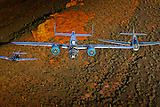 B-25 Mitchell P-51 Mustang and TBM Avenger flying in formation over Arizona desert in color image