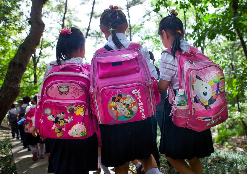 Kids with Mickey bags, Pyongyang, North Korea.