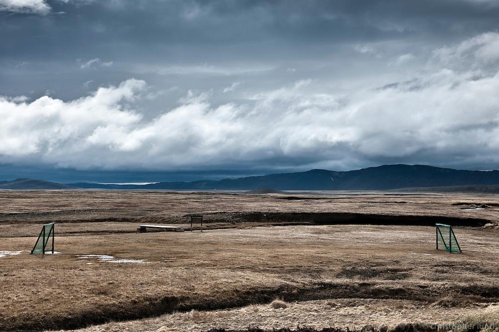 A football (soccer) field at Möðrudalur á Fjöllum, North Iceland. This farm lies the highest in Iceland, some 469 m above sea level. Möðrudalur á Fjöllum er bær á Möðrudalsöræfum á Norðurlandi eystra. Jörðin er ein sú landmesta á Íslandi og sú sem stendur hæst (469 metra yfir sjávarmáli).