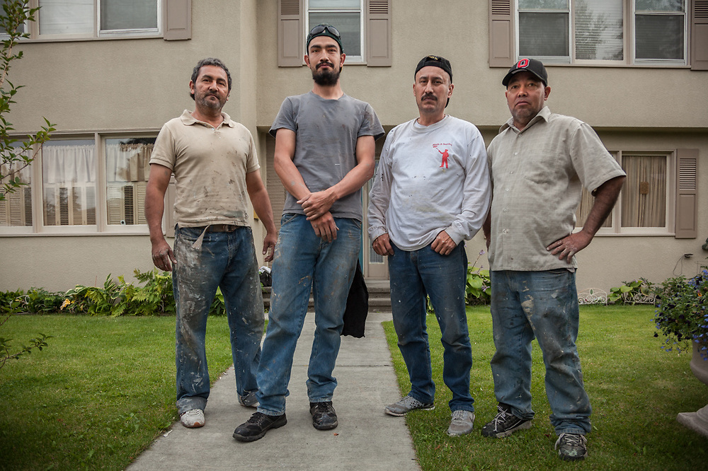 Employees of Math-A Service, Leo, Martin, Rapha, and Hugo (Boss Man) Mathey in front of the a home they have painted in Anchorage's South Addition neighborhood.