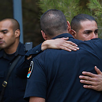 Jamie Montoya, Chief of the Las Cruces Police Department, comforts Officer Adrian De La Garza, after Montoya made a statement about retired LCPD Officer J.R. Stewart Tuesday Nov. 28, 2017. Stewart was killed Monday night when he was struck by a vehicle that was being pursued by law enforcement.